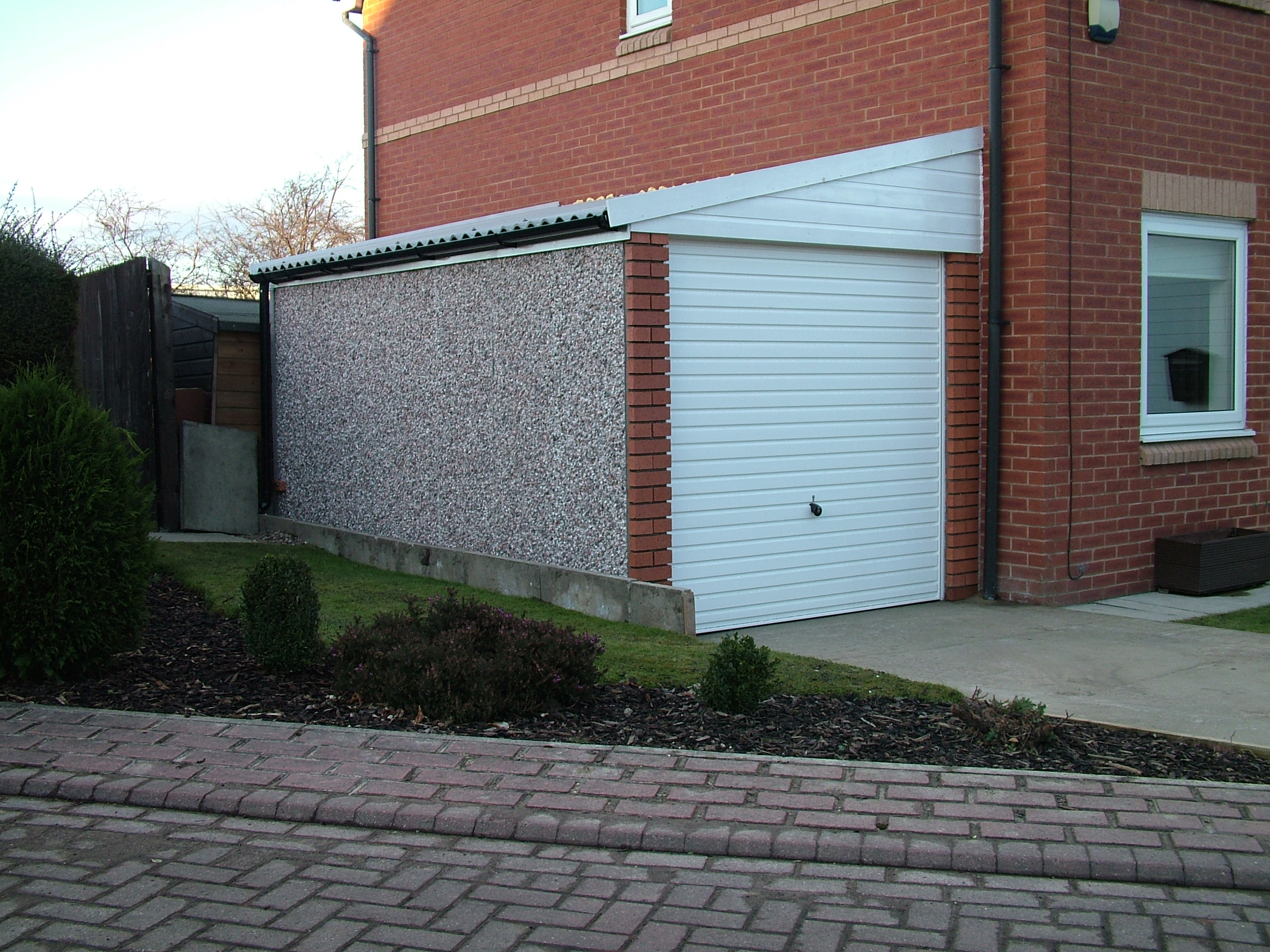 How much to build a garage on side of the house uk - When building a house ...