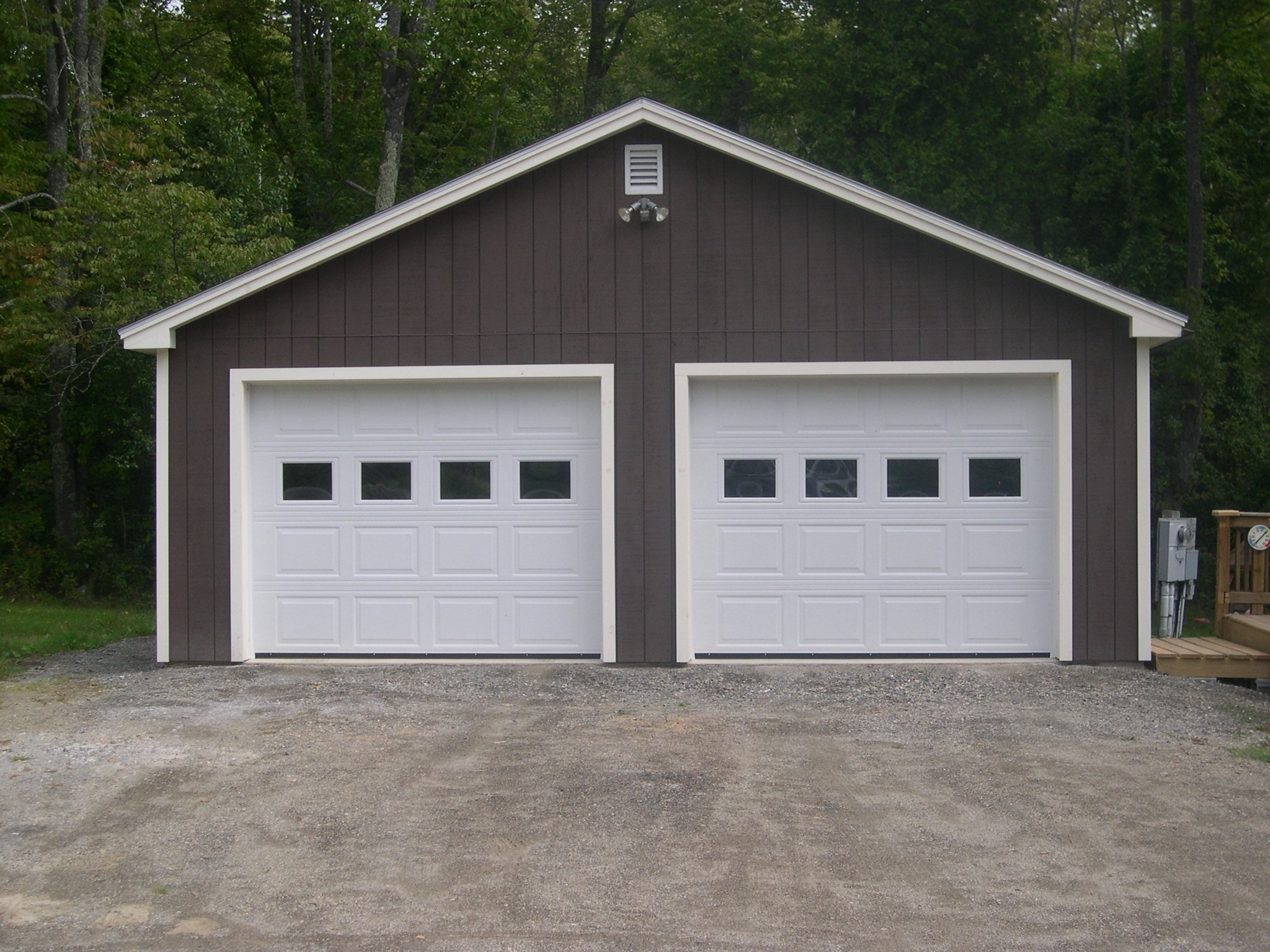 How much to build a garage on side of the house uk for Two car garage with loft cost