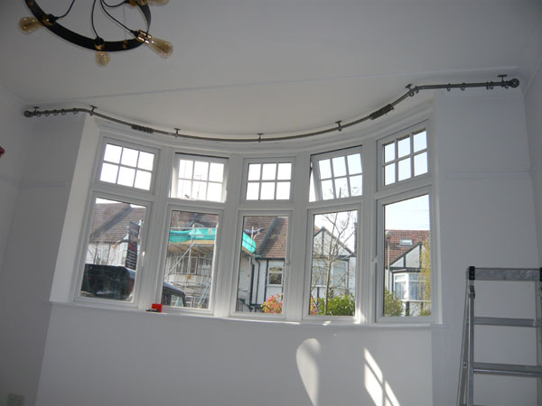 Bay window curtain poles ceiling mounted