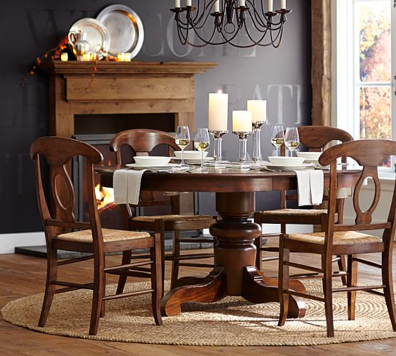 Pottery barn round dining table and chairs (2)